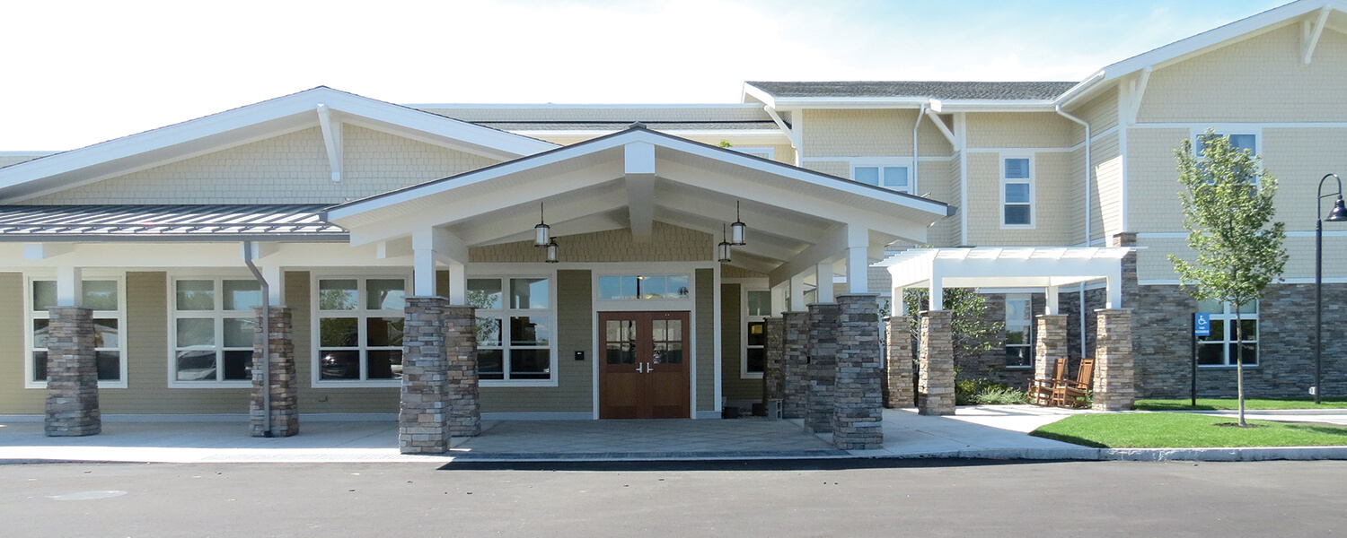 Main entrance of Bridges® by EPOCH at Westwood, a community providing Norfolk County seniors with compassionate memory care services.