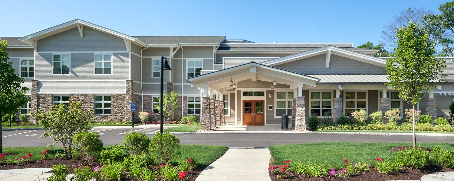 Main entrance of Bridges® by EPOCH at Trumbull, a memory care community in Trumbull, CT.