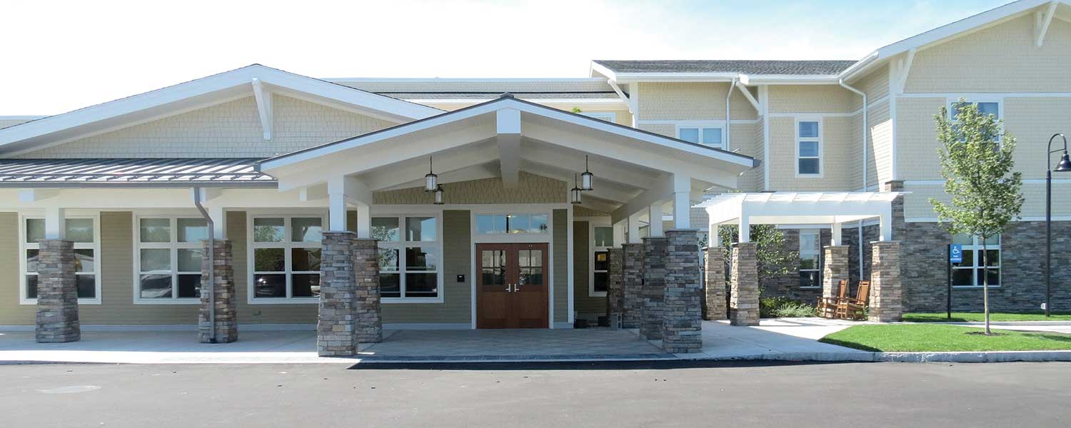 Main entrance of Bridges® by EPOCH at Westwood, a memory care community for seniors in Norfolk County.