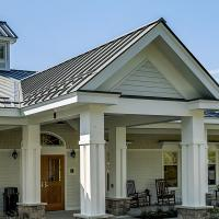 The welcoming entrance to Bridges® by EPOCH at Pembroke, a compassionate memory care community in Pembroke, MA.