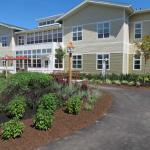 Community courtyard with walking paths, gorgeous gardens and outdoor seating.