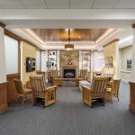 Spacious common area with fireplace and comfortable seating.